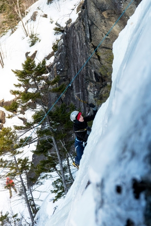 A new ice climber learning to swing tools