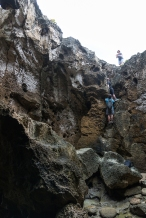 Vince and Jess climbing into Cueva del Indio