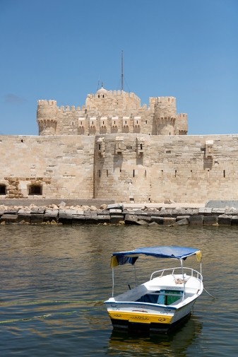 A fishing boat in front of the Citadel of QaitbayCitadel of Qaitbay
